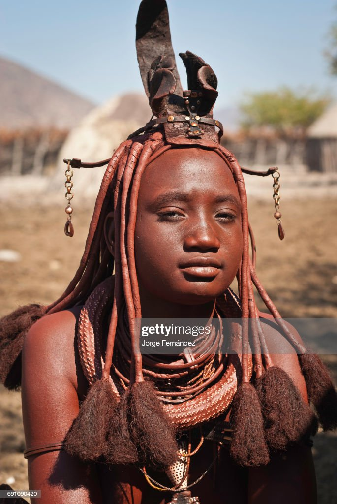 Portrait Of A Himba Woman Wearing The Traditional Hairstyle Of The