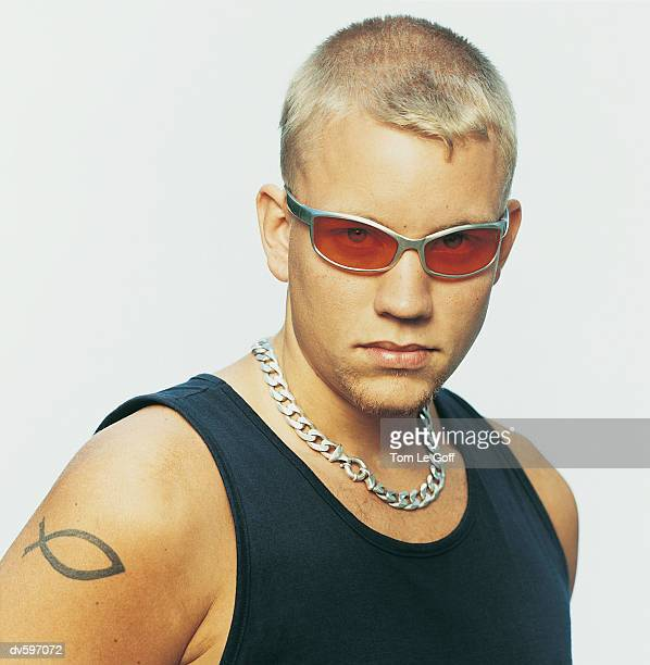 portrait of a hip young man - bleached hair stock photos and pictures