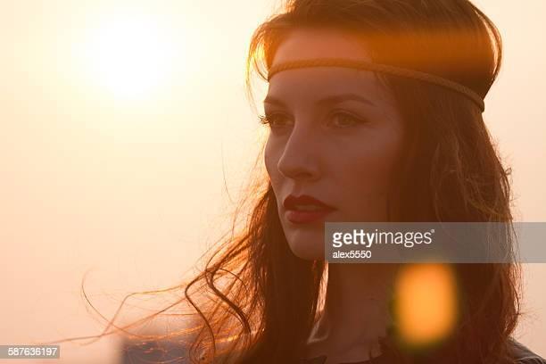 portrait of a hippie woman with headband looking - cinta de cabeza fotografías e imágenes de stock