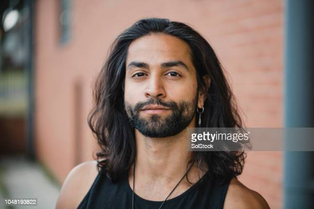 portrait of a hipster man - long hair stock pictures, royalty-free photos & images