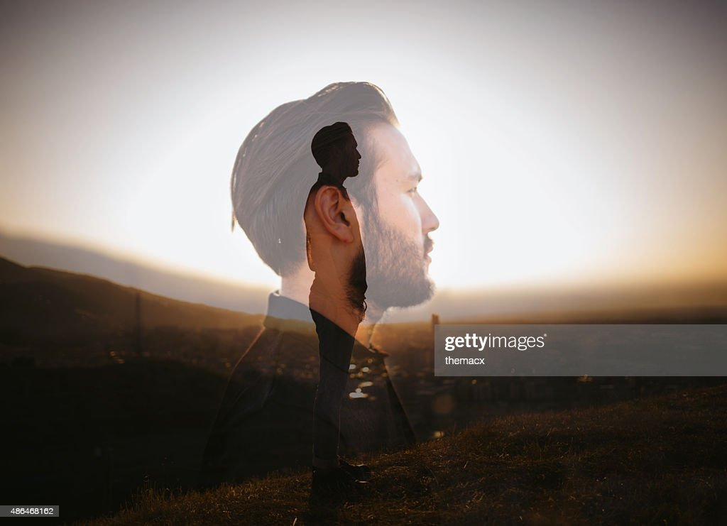 Portrait of a hipster with double exposure technique : Stock Photo