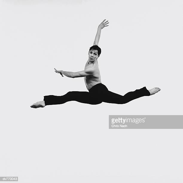 Portrait of a Hispanic Male Dancer Doing The Splits in Mid Air