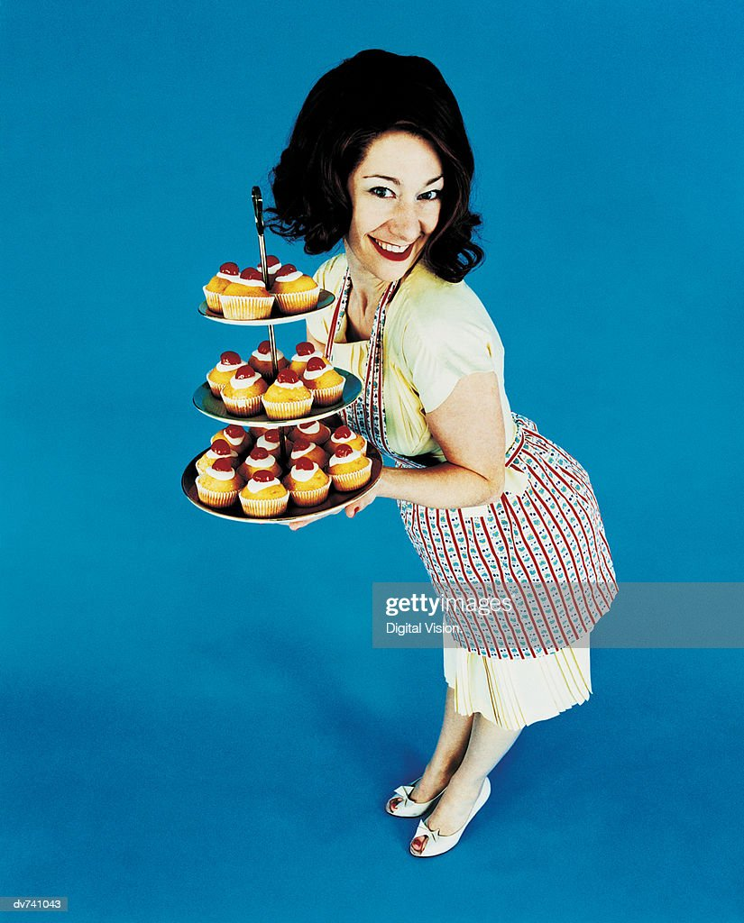 Portrait of a Housewife Holding a Tray of Cakes : Stock Photo
