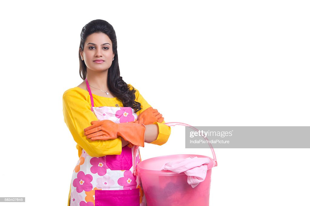 Portrait of a housewife with a bucket of clothes : Stock Photo
