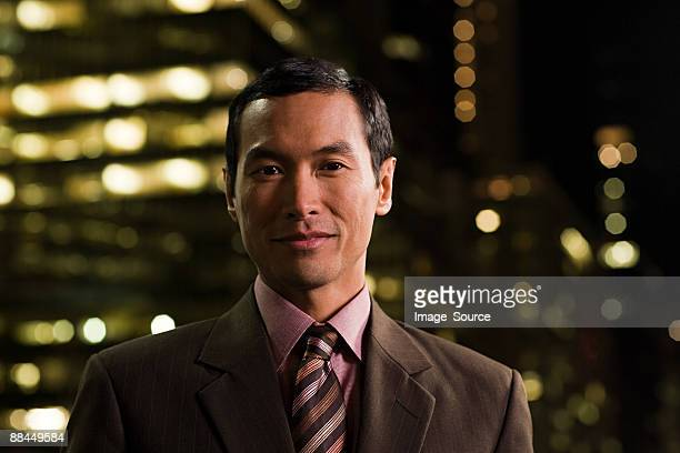 Portrait of a Japanese businessman at night