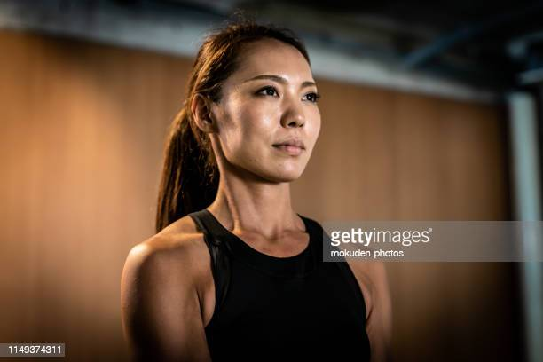 portrait of a japanese female standing in a gym - extra long stock pictures, royalty-free photos & images