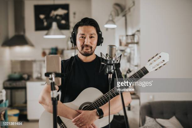 portrait of a japanese guitar player at home studio - musician stock pictures, royalty-free photos & images