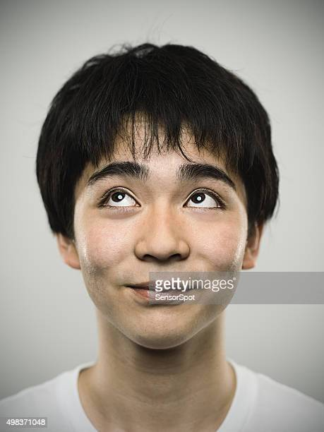 Portrait of a japanese happy teenager looking at camera