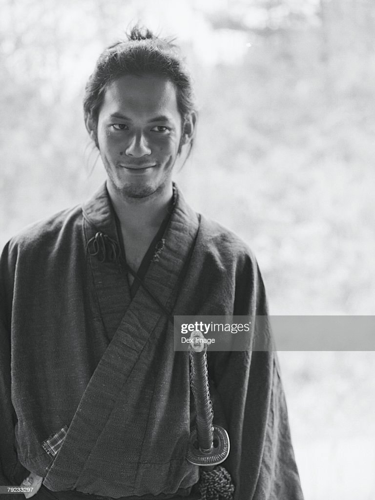 Portrait of a Japanese man in traditional costume : Stock Photo