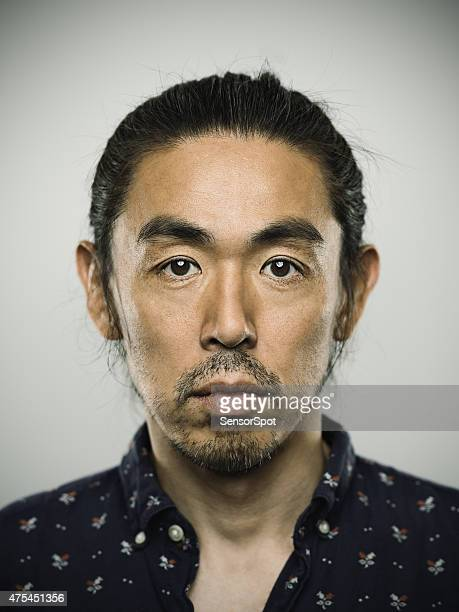 portrait of a japanese man looking at camera - fine art portrait stock photos and pictures