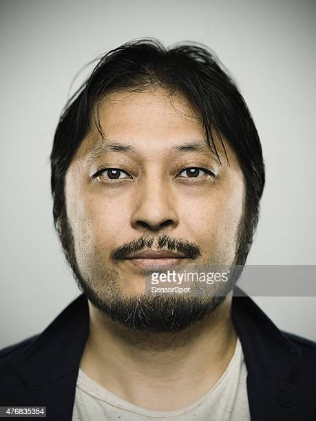 portrait of a japanese man looking at camera - mugshot bildbanksfoton och bilder