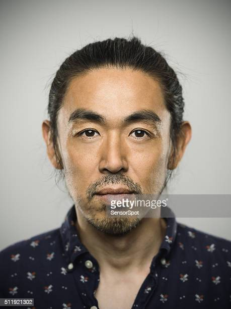 Portrait of a japanese man looking at camera.