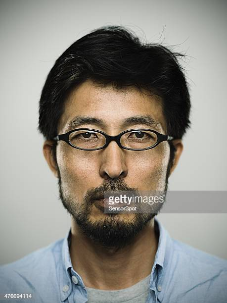 Portrait of a japanese man wearing glasses
