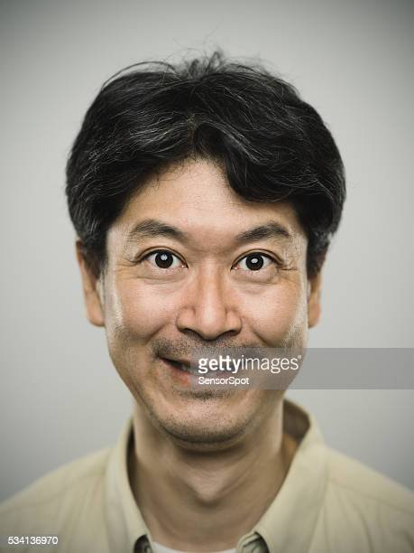 Portrait of a japanese man with happy expression.