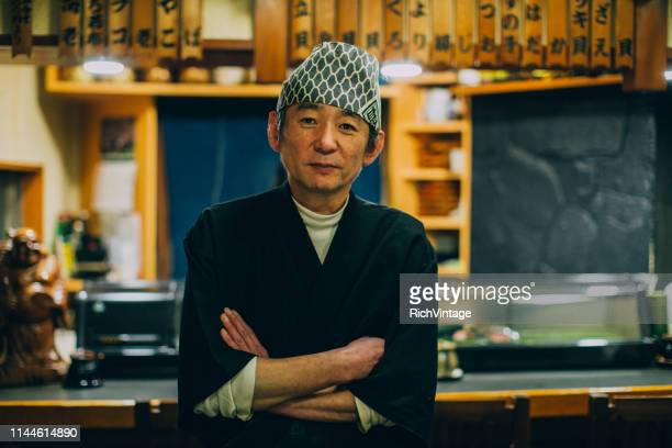 portrait of a japanese sushi chef - catering building stock pictures, royalty-free photos & images