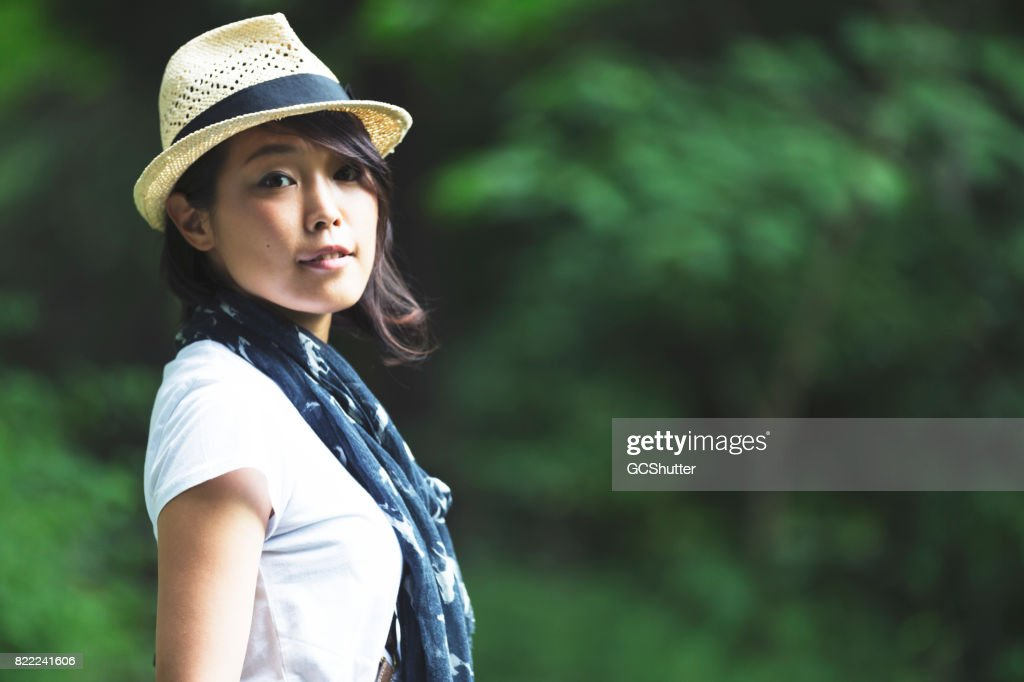 Portrait of a Japanese women with a fedora : Stock Photo