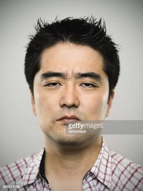 の肖像日本の若い男性カメラを見ている - 男らしさ ストックフォトと画像