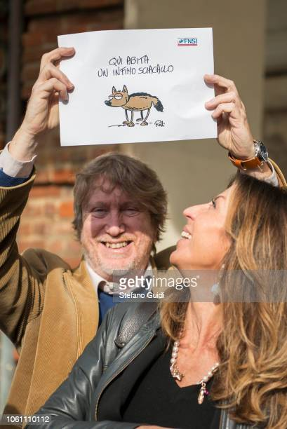 Portrait of a journalist holding a protest sign with the words 'Here a very poor jackal lives' during the journalists' protest flash mob to defend...