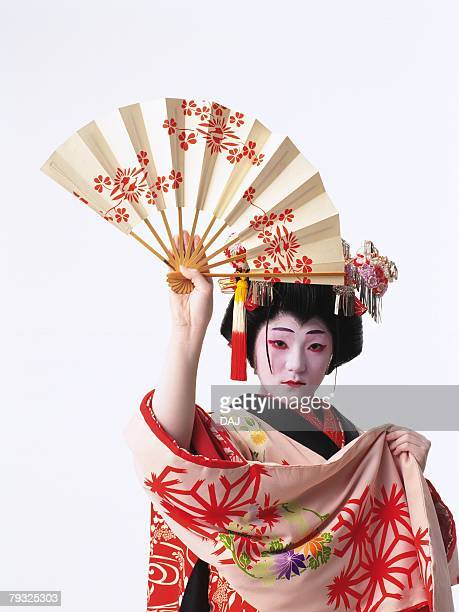 Portrait of a Kabuki actor acting as female holding a fan, Front View