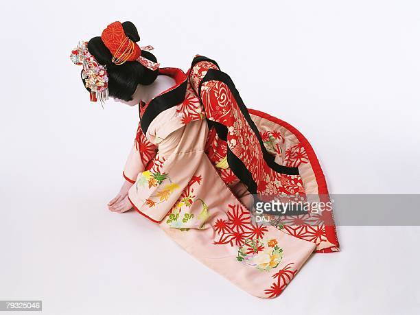 Portrait of a Kabuki actor acting as female sitting down and bowing, High Angle View