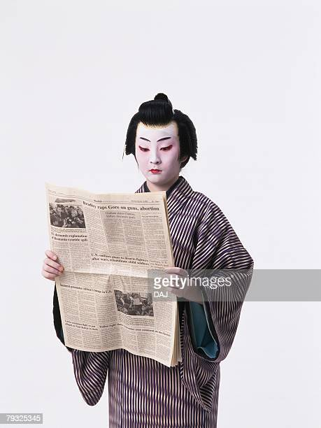 Portrait of a Kabuki actor reading news paper, Front View