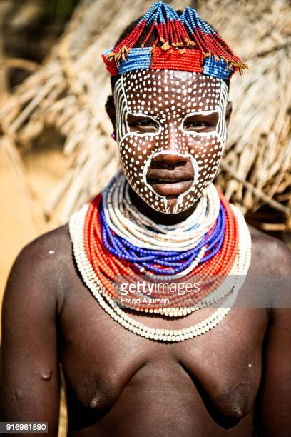 portrait of a karo tribe woman, omo valley, ethiopia - december 13, 2017 - eastern african tribal culture stock photos and pictures