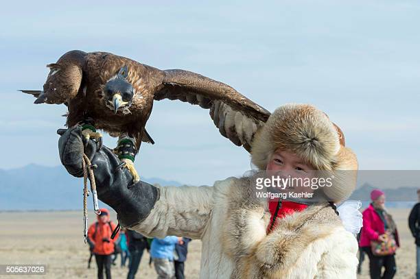 Portrait of a Kazakh teenage girl eagle hunter at the Golden Eagle Festival on the festival grounds near the city of Ulgii in the BayanUlgii Province...