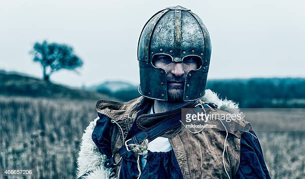 Portrait of a knight or viking with metal helmet