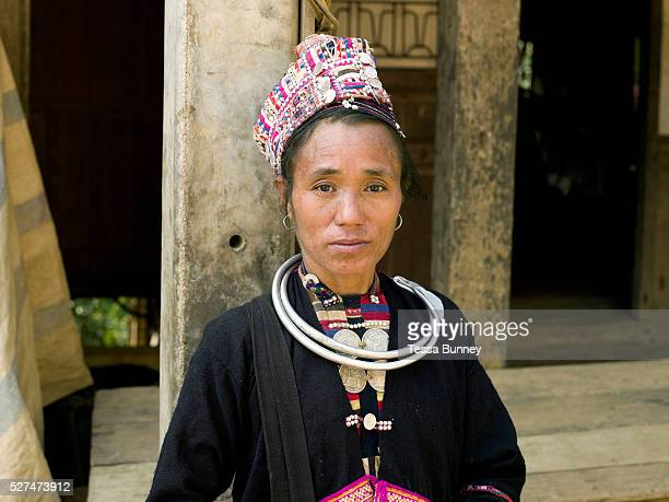 Portrait of a Ko Pala ethnic minority woman wearing her traditional clothing at Pak Nam Noi market Phongsaly province Lao PDR One of the most...