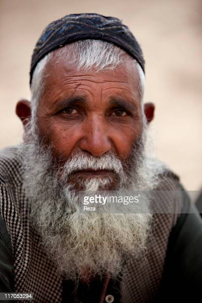 Portrait of a Kuchi nomad living in the refugee camp in the North of Kabul the Charahi Qambar camp shelters refugees from Helmand province where the...