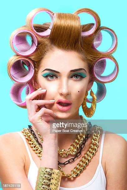 Portrait of a lady in the salon with hair curlers