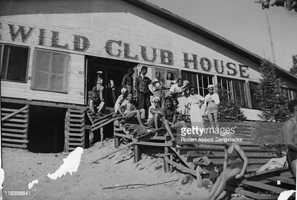 Portrait of a large group of unidentified people as they pose on the wooden steps of the Idlewild Club House Idlewild Michigan September 1938...