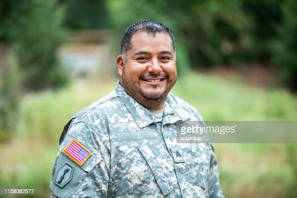portrait of a latino veteran - veteran stock pictures, royalty-free photos & images