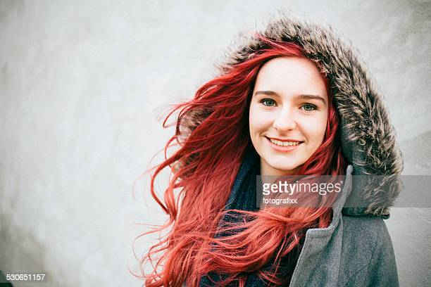 portrait of a laughing redhead teenager girl, looking at camera