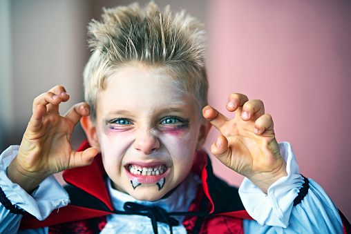 Portrait of a little boy dressed up as halloween vampire 602312914