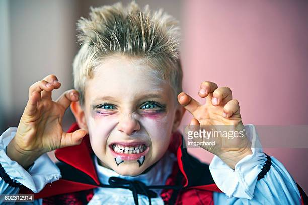 portrait of a little boy dressed up as halloween vampire - halloween kids stock photos and pictures