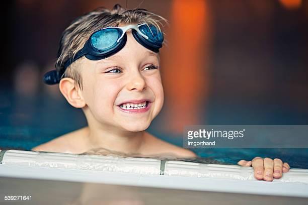 Portrait of a little boy in swimming pool