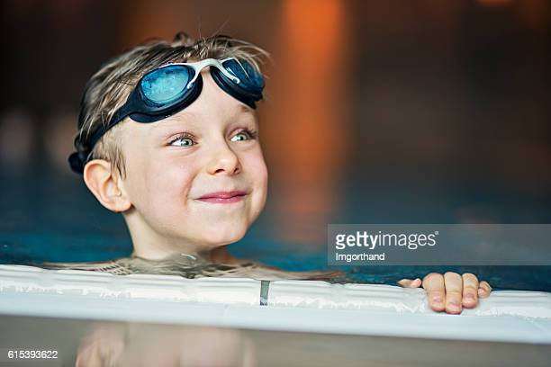 Portrait of a little boy in swimming pool