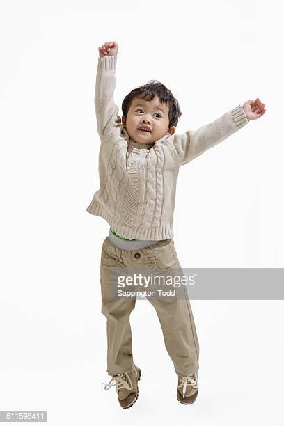 Portrait Of A Little Boy Jumping