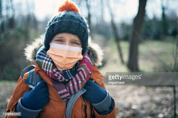 portrait of a little boy wearing anti virus mask - coronavirus winter stock pictures, royalty-free photos & images
