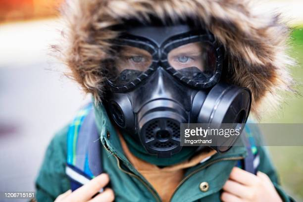 portrait of a little boy wearing gas mask - nuclear fallout stock pictures, royalty-free photos & images
