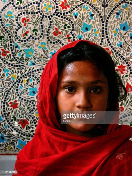 Portrait of a little girl in front of Sindh kashi tiles and mirror works inside the shrine of Bodla Bahar one of the main disciple of Lal Shahbaz...