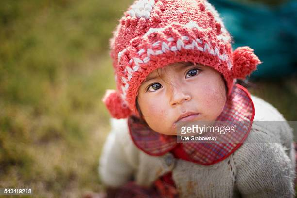 Portrait of a little girl in the Andes of Bolivia on April 15 2016 in Tawarchapi Bolivia