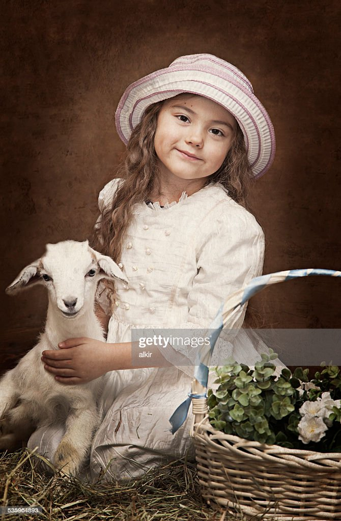 Portrait of a little girl with a baby goat : Stock Photo