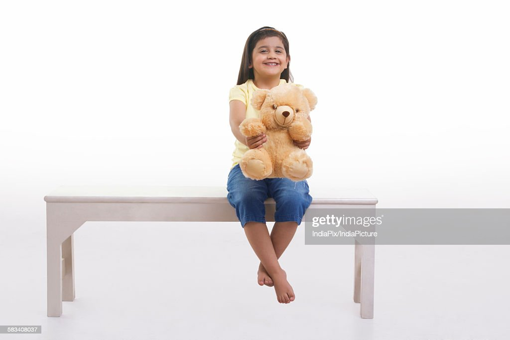 Portrait of a little girl with a teddy bear : Stock Photo