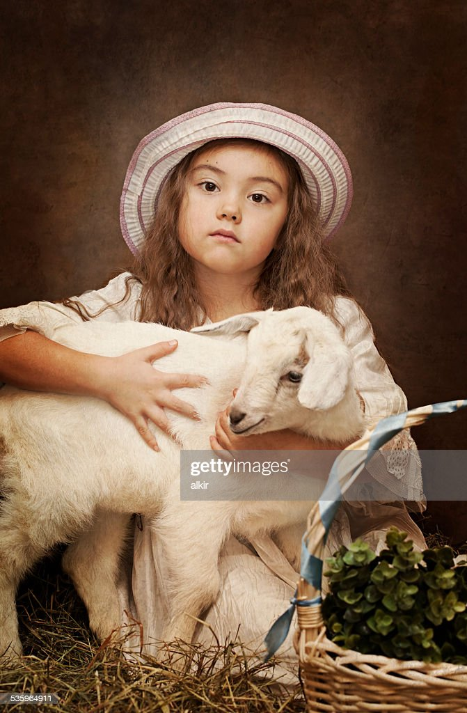 Portrait of a little girl with her pet goat : Stock Photo