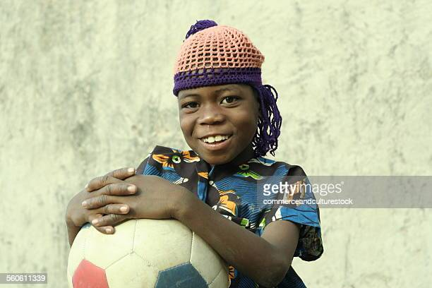 Portrait of a little villager with football