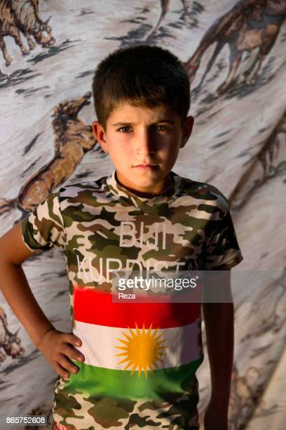 Portrait of a little Yazidi boy inside the Cham Mishko refugee Camp The boy and his brethren waver between the solemnity of those who have lost...