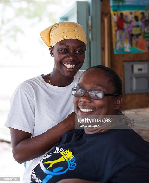 Portrait of a local bahamian business woman with her daughter at their foodstall at New Bight Beach on June 15 2012 in Cat Island The Bahamas