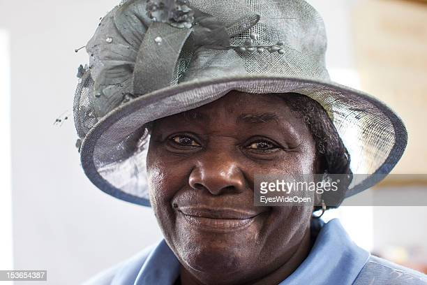 Portrait of a local bahamian old woman the lady is wearing a hat while attending the sunday service in the Zion Baptist Church in Old Bight on June...